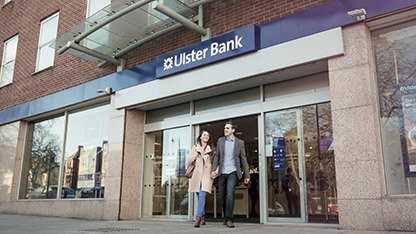 Couple leaving Ulster Bank branch