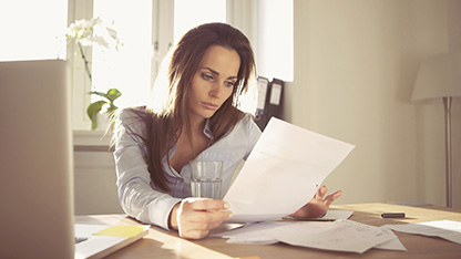 Woman reading bank statements