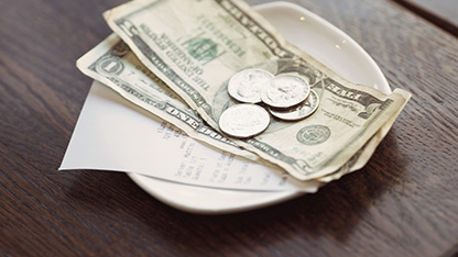 US dollars on plate