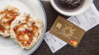 Credit card used to pay for a coffee
