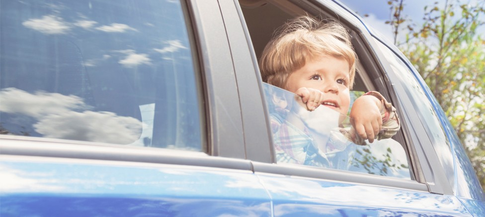Young boy looking out of car window