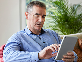 Image of a man using a tablet for Video Banking